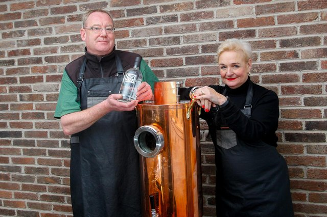 NB Distillery's Steve Ross, head of production, and Rhona Hartley, head of corporate sales and retail, with 'Dolly' the dispenser that will be used to refill customers gin bottles in an eco-friendly initiative for the spirit firm