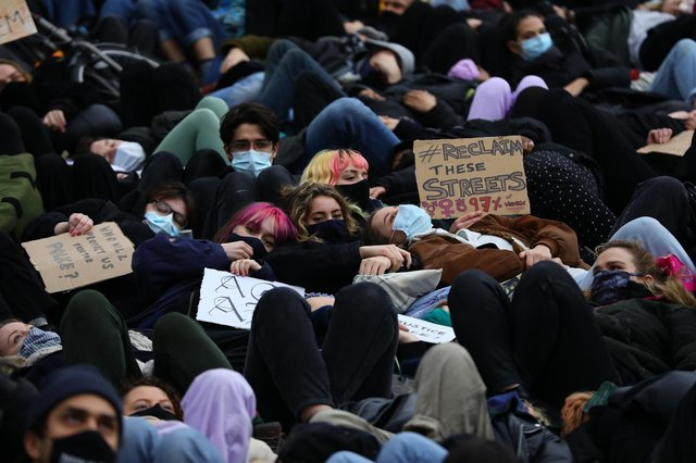 People take part in a minute's 'die-in' at Parliament Square in London on Sunday, the day after clashes between police and crowds who gathered on Clapham Common to remember Sarah Everard (Picture: Aaron Chown/PA)
