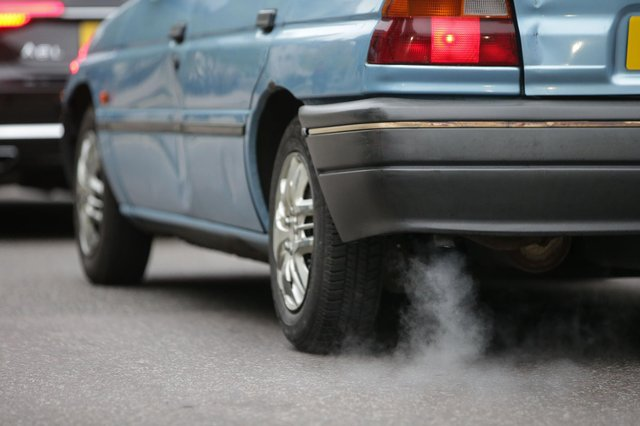 Children can no longer be legally exposed to second-hand cigarette smoke in cars, but they will be breathing in fumes from the exhaust (Picture: Daniel Leal-Olivas/AFP via Getty Images)
