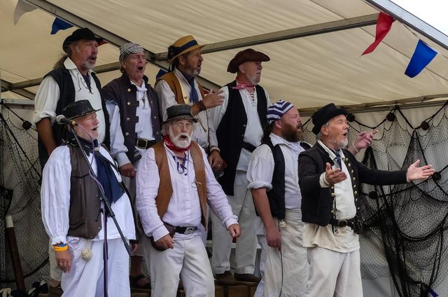 Nowadays, sea shanties are usually the domain of groups like The Exmouth Shanty Men, seen here performing at Great Yarmouth's annual Maritime Festival (Photo: Shutterstock)