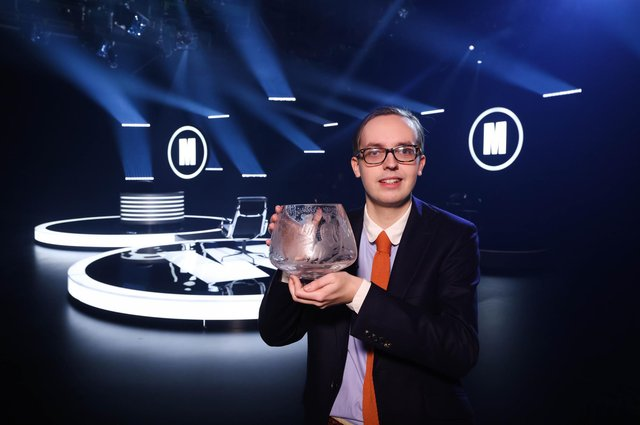 Glasgow student Jonathan Gibson, aged 24, shows off the coveted Caithness Glass trophy after becoming the youngest ever winner of Mastermind