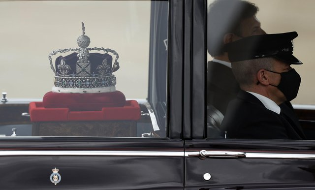 The Imperial State Crown is taken to the Palace of Westminster in London for the State Opening of Parliament, Tuesday May 11, 2021. Picture: AP Photo/Alastair Grant