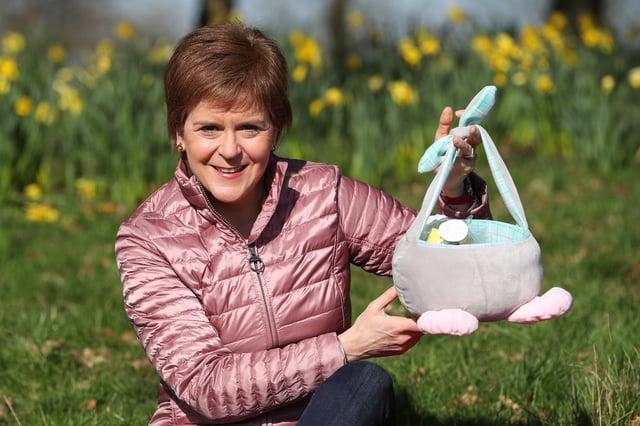 Scotland's First Minister Nicola Sturgeon holds a basket at Ruchill Park in Glasgow.