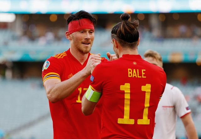 Gareth Bale congratulates Kieffer Moore after his goal earned Wales a draw with Switzerland