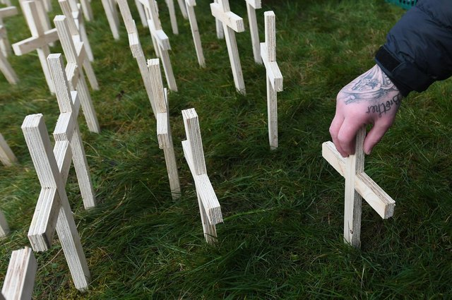 Crosses are planted in memory of drugs death victims at Springburn Parish Church, Glasgow