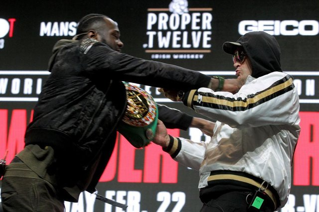 Deontay Wilder and Tyson Fury get into an altercation during their press conference at the MGM Grand Las Vegas (Photo: JOHN GURZINSKI/AFP via Getty Images)