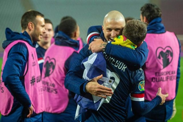 Scotland's Callum McGregor and Lyndon Dykes  celebrate at full time (Photo by Nikola Krstic / SNS Group)