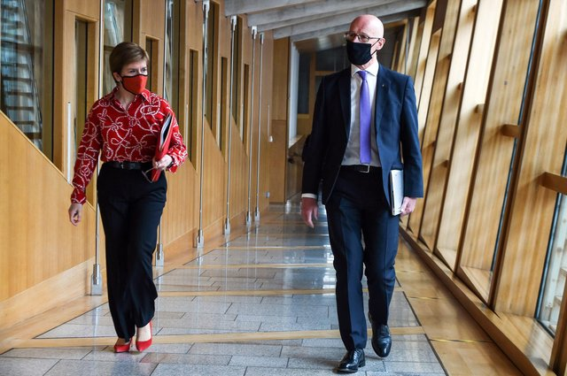 SNP leader Nicola Sturgeon arrives at Holyrood with Deputy First Minister John Swinney. Picture: Andy Buchanan/PA Wire