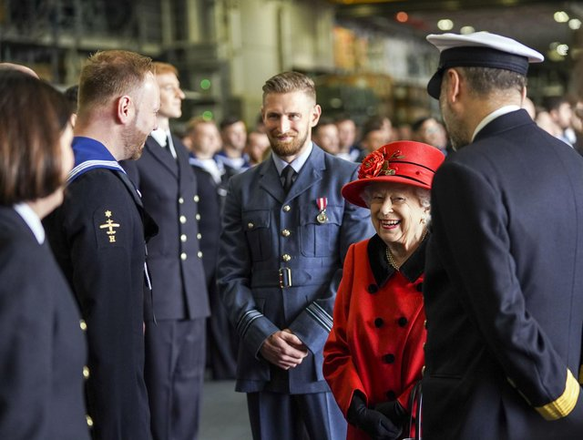 Queen Elizabeth II during a visit to HMS Queen Elizabeth at HM Naval Base, Portsmouth, ahead of the ship's maiden deployment. The visit comes as HMS Queen Elizabeth prepares to lead the UK Carrier Strike Group on a 28-week operational deployment travelling over 26,000 nautical miles from the Mediterranean to the Philippine Sea.