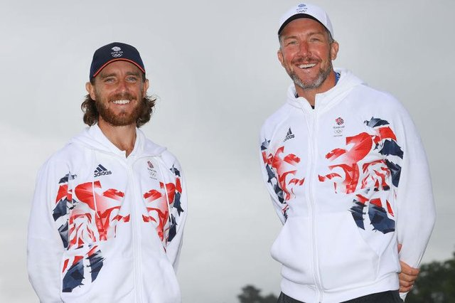 Tommy Fleetwood and his caddie Ian Finnis pose for a photo to mark the official announcement of the Team GB golf team for the Tokyo 2020 Olympic Games. Picture: Andrew Redington/Getty Images for British Olympic Association.