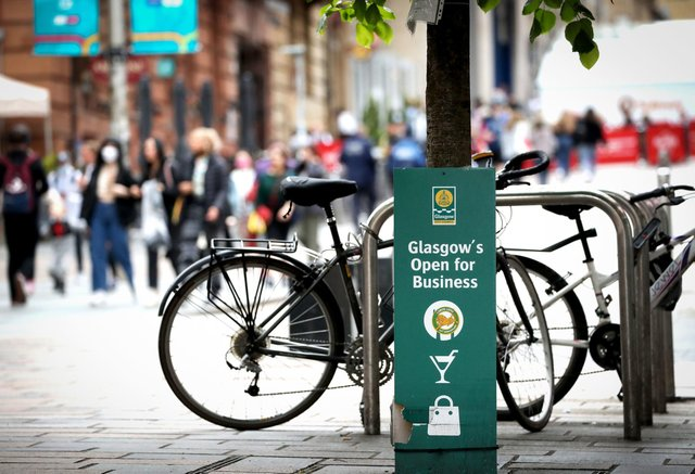 """A sign reads """"Glasgow's Open for Business"""" in Glasgow city centre. Picture: Jane Barlow/PA Wire"""