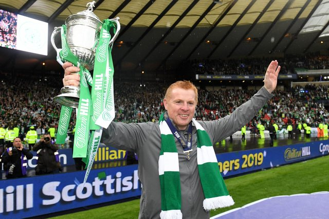 Celtic manager Neil Lennon holds the Scottish Cup aloft after the club completed the treble treble with the 2019 final win over Sunday's opponents' Hearts. (Photo by SNSGroup/Alan Harvey)
