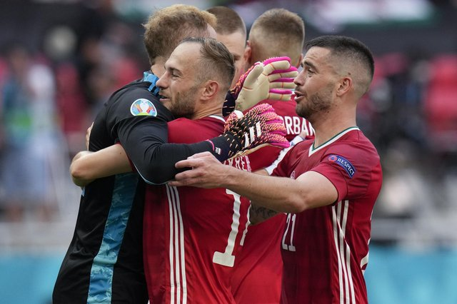 Hungary's Peter Gulacsi, Endre Botka and Attila Szalai celebrate at the end of the Euro 2020 soccer championship group F match between Hungary and France, at the Ferenc Puskas stadium in Budapest, Saturday, June 19, 2021. The match ended in a 1-1 draw. (AP Photo/Darko Bandic)