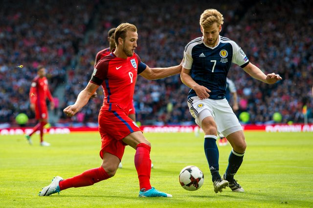 England's Harry Kane takes on Stuart Armstrong during the 2-2 draw at Hampden in 2017, the last time the two nations met. Picture: SNS