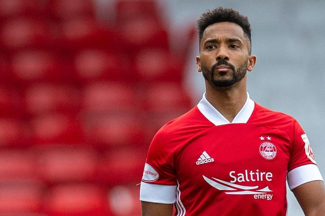 Aberdeen full back Shay Logan was playing golf while his team were losing at Tannadice  (Photo by Ross MacDonald / SNS Group)