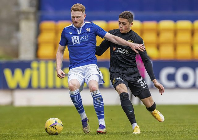 St Johnstone's James Brown and Livingston's Jaze Kabia in action.