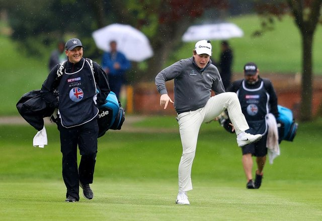 Bob Macintyre gives his caddie Mikey Thomson a laugh as he jokes around makes his way towards the 18th green during the second round of the Betfred British Masters hosted by Danny Willett at The Belfry. Picture: Picture: Richard Heathcote/Getty Images.