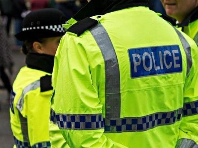A man has been arrested after another man was found dead in a Glasgow close.