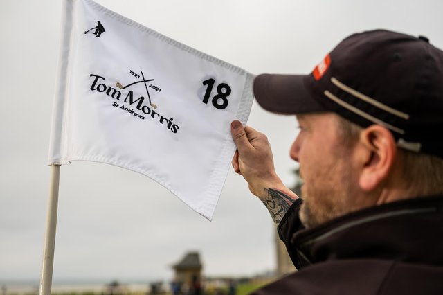 A commemorative pin flag, featuring Old Tom's name, iconic cross clubs and bicentenary dates will proudly fly on the 18th green of the Old Course on Wednesday. Picture: St Andrews Links Trust
