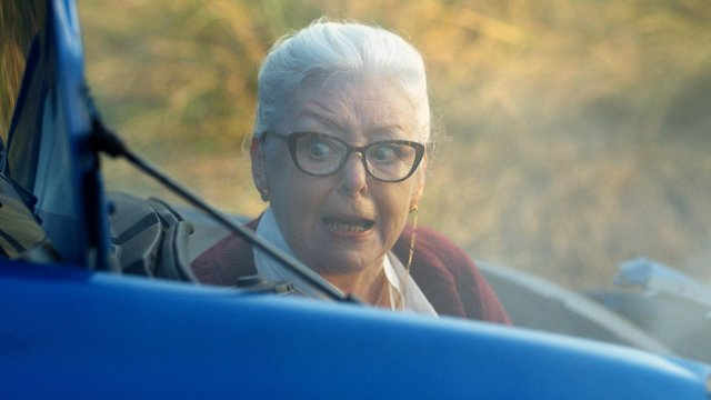 'Gran' climbing out of the crashed car in the advert