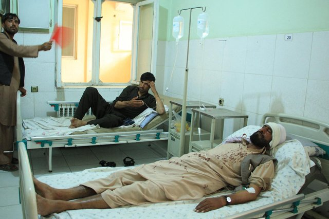 Wounded people being treated after an attack on Halo Trust charity workers in Afghanistan - which some believe the Taliban is responsible for (Getty Images)