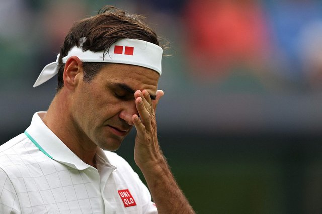 Roger Federer groans as another volley goes uncharacteristically awry