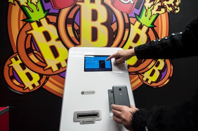 The Bitcoin cryptocurrency has even found itself into ATMs. Picture: John Devlin
