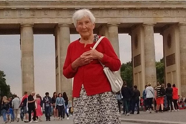 Teresa Vass in front of the Brandenburg Gate in Berlin