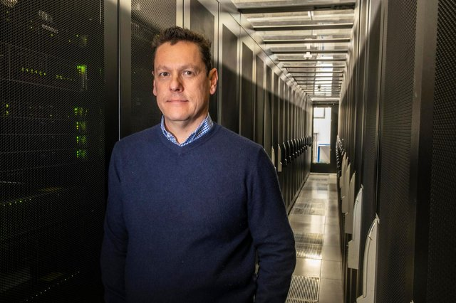 Iomart chief executive Reece Donovan in one the company's data centres. Picture: Peter Devlin