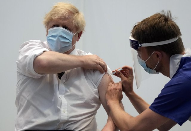 Prime Minister Boris Johnson receiving his second jab of the AstraZeneca vaccine from James Black, at the Francis Crick Institute in London on Thursday.