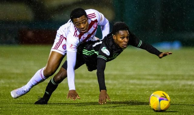 Tunde Owolabi and Jeremie Frimpong during the Scottish Premiership match between Hamilton and Celtic at the FOYS Stadium on December 26, 2020, in Hamilton, Scotland. (Photo by Craig Williamson / SNS Group)