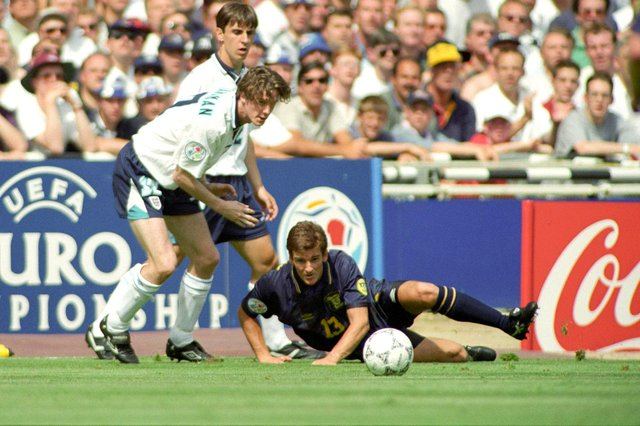 Tosh McKinlay in action for Scotland against Steve McManaman of England at Wembley during Euro 96