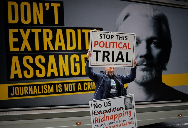 A demonstrator protests outside of the Old Bailey court in London as a request to extradite WikiLeaks founder Julian Assange by the US authorities is considered (Picture: Tolga Akmen/AFP via Getty Images)