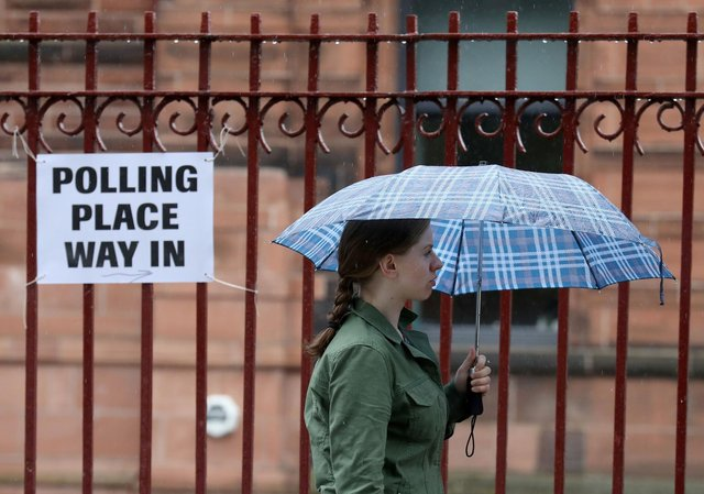 Voters arrive to cast their votes at a polling station at Notre Dame Primary School in Glasgow in the 2017 general election. Picture: PA