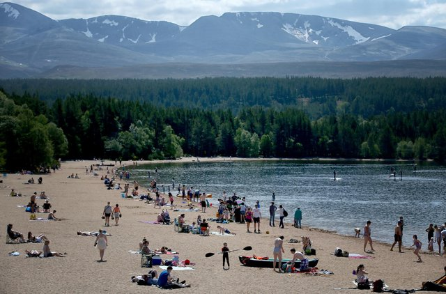 Loch Morlich, on the edge of Glenmore Forest in the Cairngorms National Park, became a popular destination for visitors as Scotland sizzled in the hottest day of the year on Spring Bank Holiday Monday. Picture: PA
