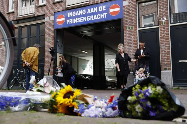 This picture taken in Amsterdam on July 7, 2021 shows flowers in  support of Peter de Vries.
