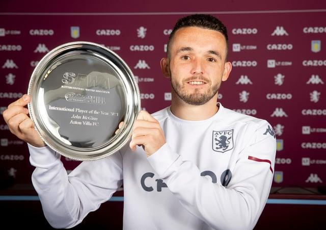 Aston Villa midfielder John McGinn with the Scottish Football Writers International Player of the Year award.