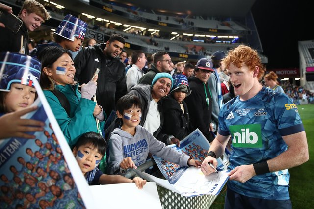 Scottish-born scrum-half Finlay Christie celebrates with the crowd after the Blues' victory over the Highlanders in the Super Rugby Trans-Tasman Final at Eden Park on Saturday. Picture: Fiona Goodall/Getty Images
