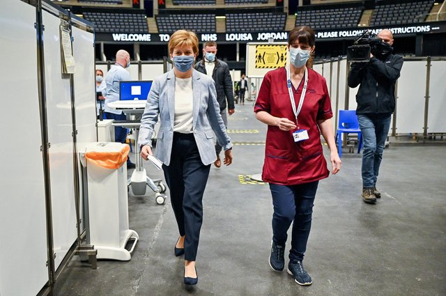 First Minister of Scotland Nicola Sturgeon arrives to receive her second dose of the Oxford/AstraZeneca Covid-19 vaccine at the NHS Louisa Jordan vaccine centre in Glasgow, Scotland. Picture date: Monday June 21, 2021.