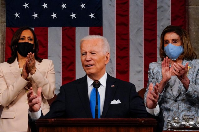 US President Joe Biden addresses a joint session of Congress as Vice President Kamala Harris (L) and Speaker of the House Nancy Pelosi (R) look on in the House chamber of the US Capitol in Washington DC. (Pic: Getty Images)