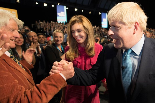 Boris Johnson is congratulated by his father Stanley Johnson after delivering his keynote speech on the final day of the annual Conservative Party conference in Manchester in 2019 (Picture: Stefan Rousseau/pool/AFP via Getty Images)
