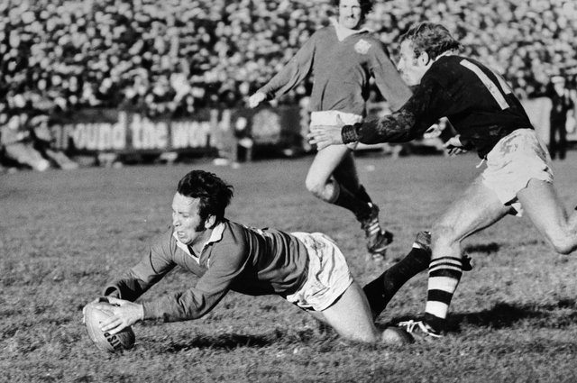 Lions captain John Dawes gets over the line for a try despite the efforts of Otago winger Bruce Hunter during the 1971 tour of New Zealand. Picture: Central Press/Hulton Archive/Getty Images