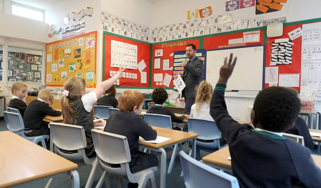 The number of pupils absent from school in Scotland due to Covid-related reasons has risen by a third in the past week