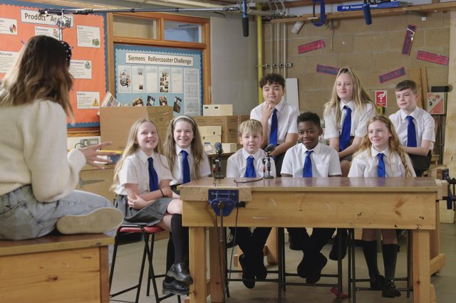 BBC presenter Lauren Layfield with school children in Let Talk About Periods.