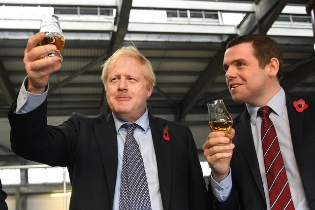Prime Minister Boris Johnson with Douglas Ross during the General Election campaign. Mr Ross says there is no definite plan for Mr Johnson to be in Scotland for the Holyrood election campaign.