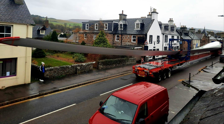 Watch: Colossal wind turbine blades manoeuvre in convoy through Highland village