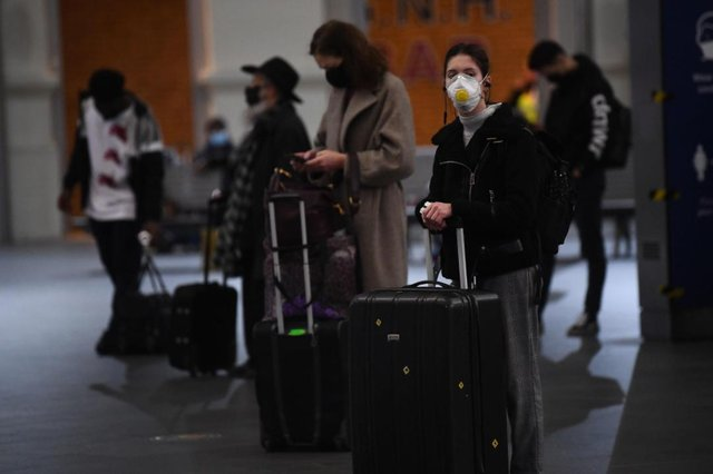 Travellers wait for trains on the concourse at King's Cross train station. Pic: Victoria Jone/PA Wire