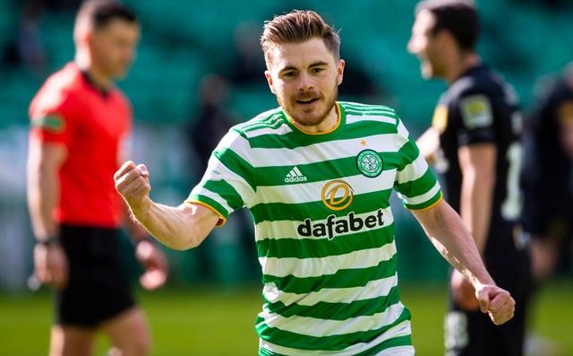 James Forrest celebrates opening the scoring for Celtic against Livingston.