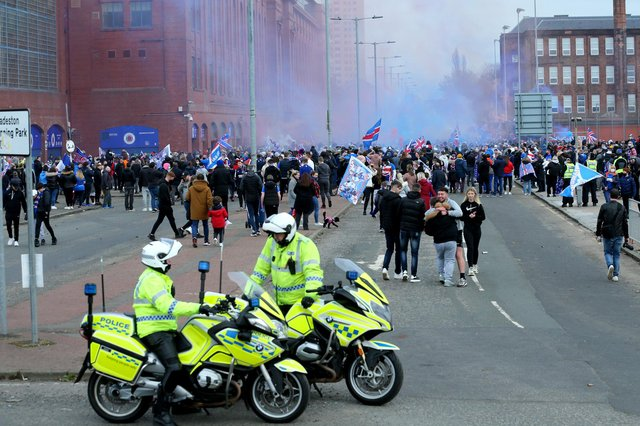 Police park up outside of the Ibrox Stadium as fans gather to celebrate Rangers winning the Scottish Premiership title on March 7.