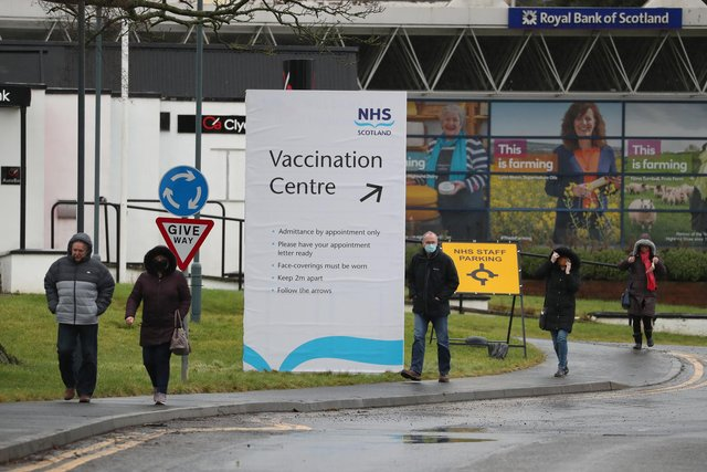 People walk passed a Vaccination Centre sign at the Royal Highland Centre in Ingliston. Picture: PA Media